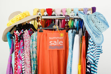 28905fd70bc8b Close up on a big sale sign for summer clothes on clearance rack ...
