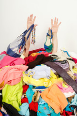 Keuken foto achterwand Magische wereld Man hands reaching out from big pile of clothes and accessories,