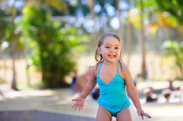 little girl in swimsuit have a fun on a vacation