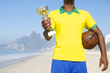Champion Brazilian Footballer Holding Trophy and Soccer Ball