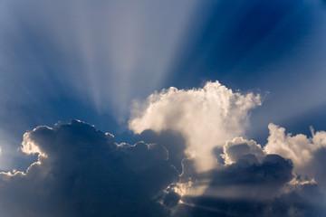 Clouds in sky with sunrays on sunrise