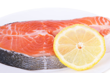 salmon with lemon on a plate