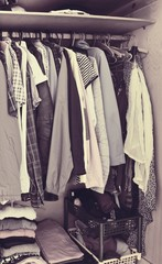 Colorful clothes hanging in wardrobe - vintage style