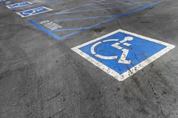 Empty handicapped parking spaces,disabled icon.Black asphalt.