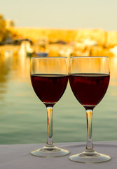 Wine glasses on the table with sea background