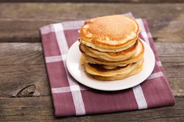 Delicious pancakes on a wooden table
