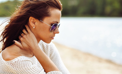 Profile of a beautiful brunette woman in sunglasses