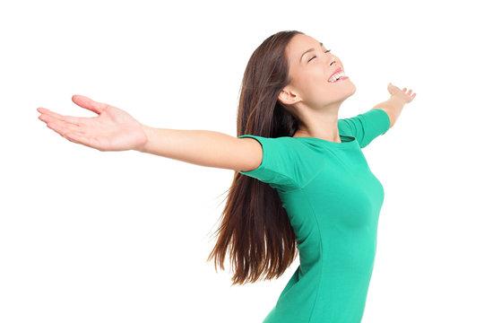 Happy worshipping praising joyful elated woman
