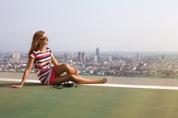 Beautiful woman photographer on the roof