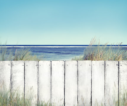Beach and White Wooden Fence