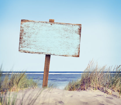 Beach with Empty Plank Sign