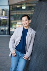 Smiling asian man posing outdoors