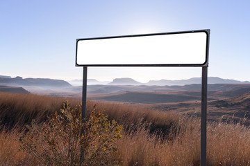 Dry Winter Rural Landscape with Blank Sign in Foreground