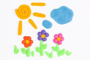 Plasticine sun, sky, cloud and flower.