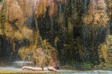 one woman bathing ma'in hot springs waterfall Jordan