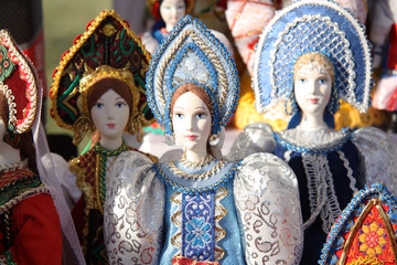 Russian dolls in traditional national russian clothes