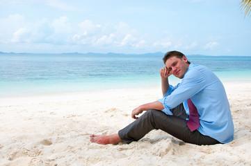 Business man on the beach