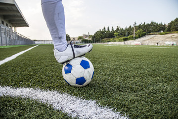 soccer field with ball and foot