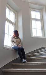 asian woman by window