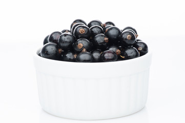 black currant in white bowl