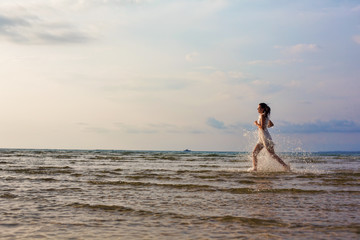 Beautiful woman running on the sea, freedom to Travel vacations