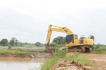 Heavy excavator loader at soil moving works