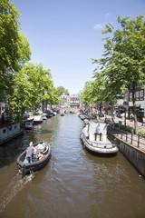 AMSTERDAM, NETHERLANDS, JUNE 8 2014: boats in Spiegelgracht in A