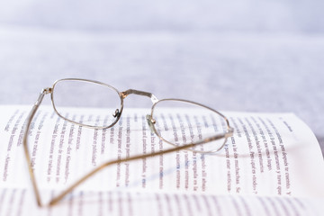 Open book with old glasses