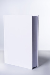Blank book on light gray background