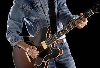 playing rock and roll guitar