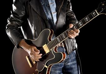 playing rock guitar