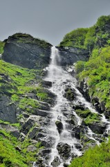 High waterfall in Carpathians mountains