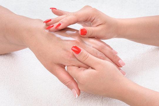 beauty salon, hands massage with moisturizing cream