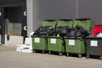 Green garbage containers  near large food shop