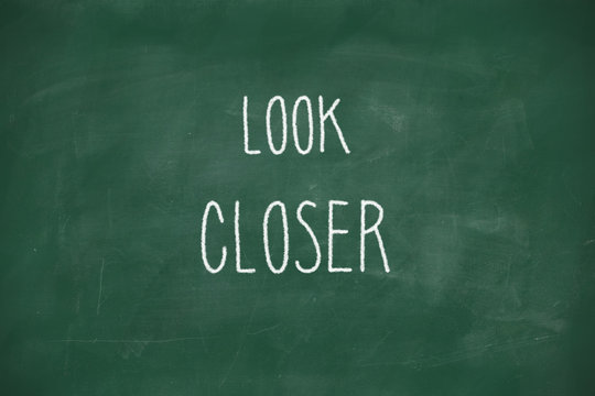Look closer handwritten on blackboard