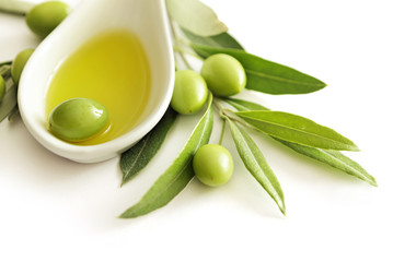 olive oil and green olives isolated
