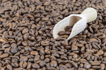 Coffee beans and wooden shovel