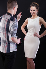 Photographer showing ok gesture to his female model