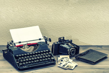 Antique typewriter and vintage photo camera