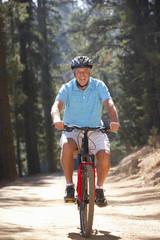 Senior man on country bike ride