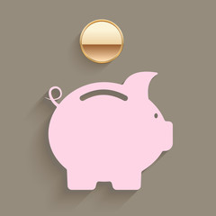 Pink piggy bank with a gold coin