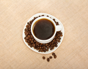 Cup of coffee and saucer, grains