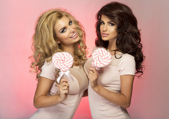 Two pretty girls posing