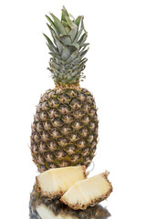 Sliced ​​and whole pineapple