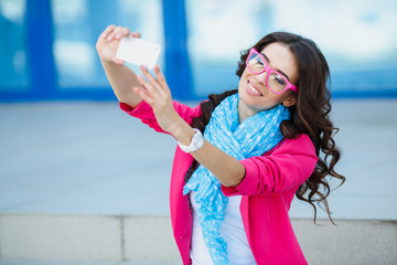 Girl taking pictures of yourself on your cell phone