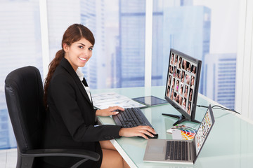 Businesswoman Looking At Color Swatches At Desk