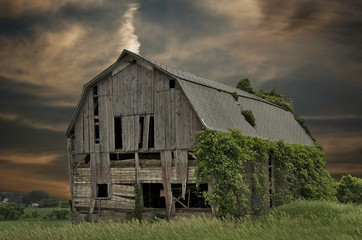dilapidated barn with sunset sky