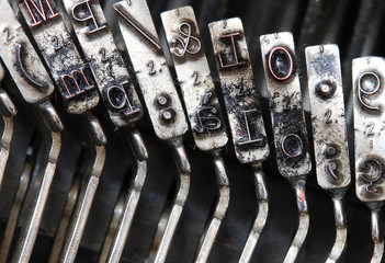 detailed particular letters of an old typewriter ink stained 2