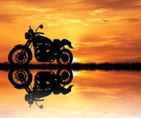 Fototapete - motorcycle at sunset