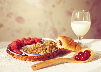 Healthy breakfast with milk and croissants. Fresh tasty berries.